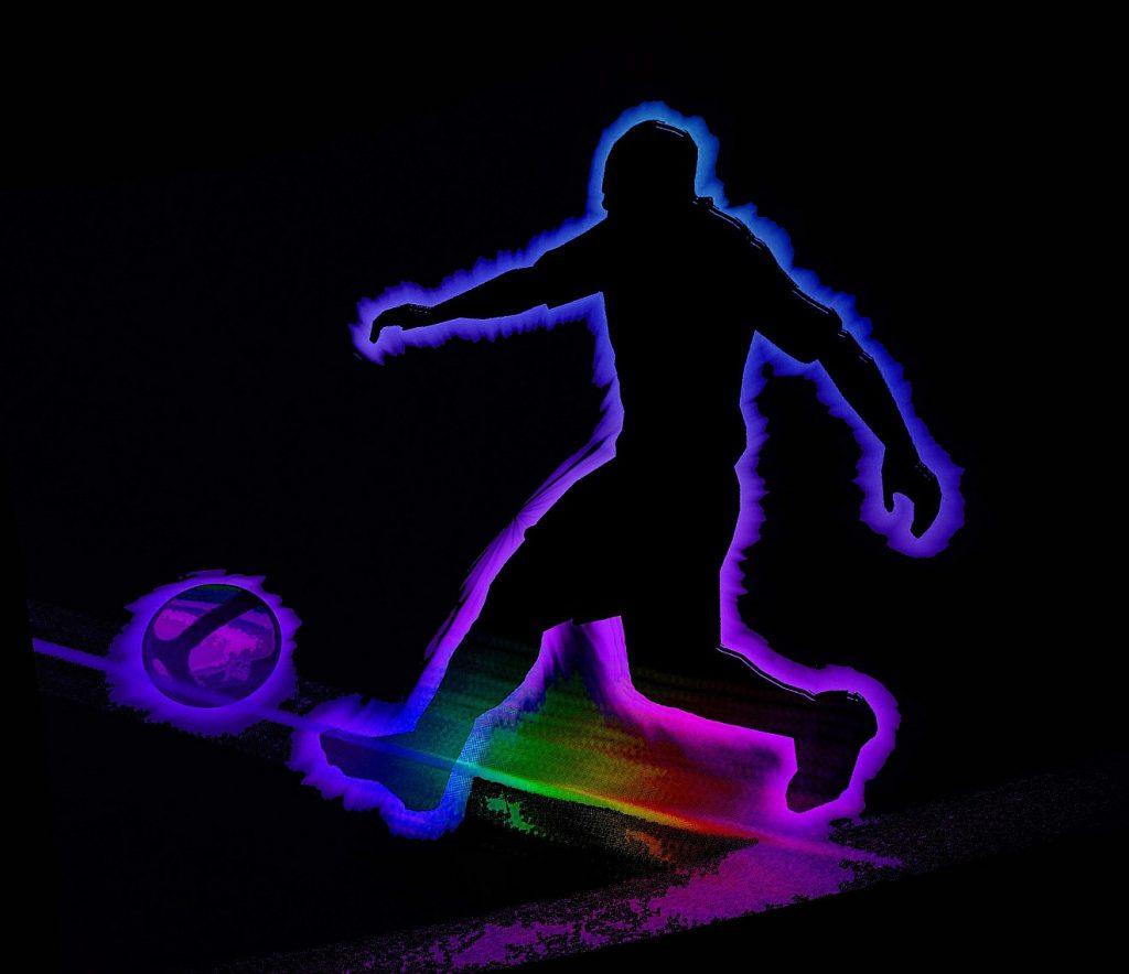Fußballpredigt: Das Bild zeigt den farbig leuchtenden Umriss eines Fußballspielers mit Ball vor schwarzem Hintergrund
