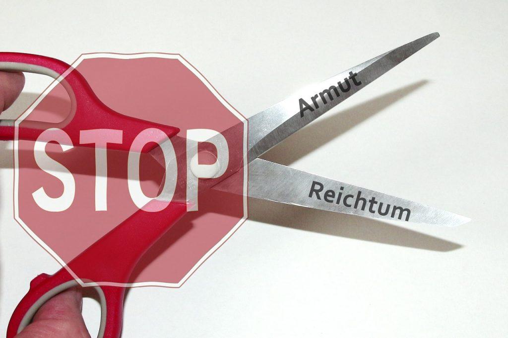 Stopp-Schuld mit der Schere zwischen Armut und Reichtum