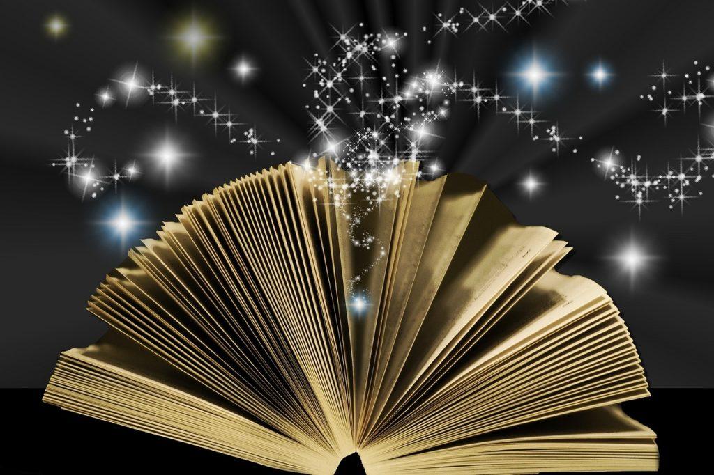 Die aufgeschlagenen Seiten der Bibel versprühen Zaubersterne