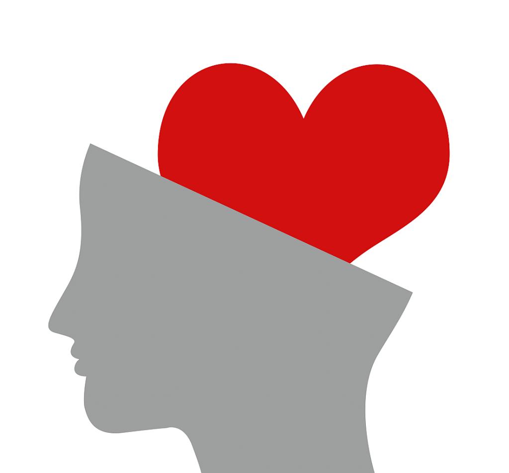 Emotionale Intelligenz: Ein stilisiertes graues Gesicht im Profil, das schräg abgeschnitten ist, so dass es aussieht, als ob ein rotes Herz im Kopf drinsteckt