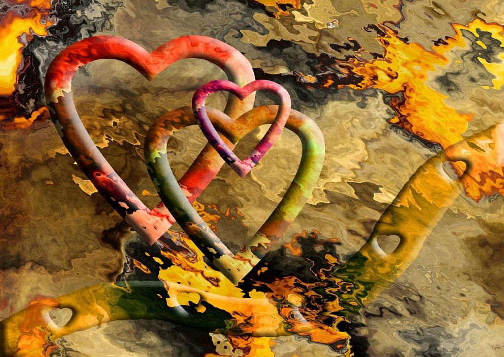 Eine Familie mit einem Reichtum an Gefühlen: Mehrere bunte Herzen stehen zusammen wie Vater, Mutter, Kind, ein farbiges Band mit Herzen schlingt sich daran entlang, im Hintergrund weitere Farbeffekte