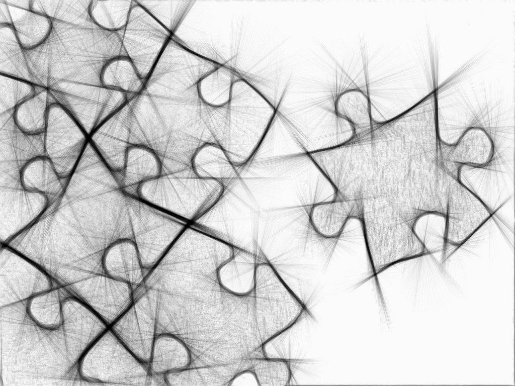 Puzzleteile im Umriss, schwarzweißgrau gezeichnet, die nicht unbedingt zusammenpassen