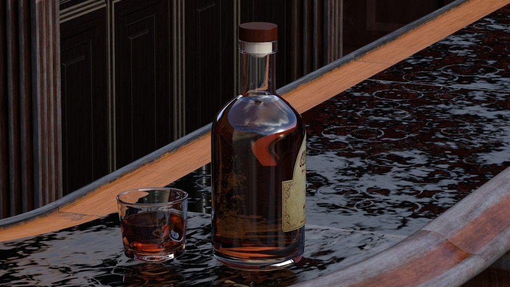 Schluss gemacht mit dem Alkohol: Eine Flasche Whisky mit Glas steht im Regen