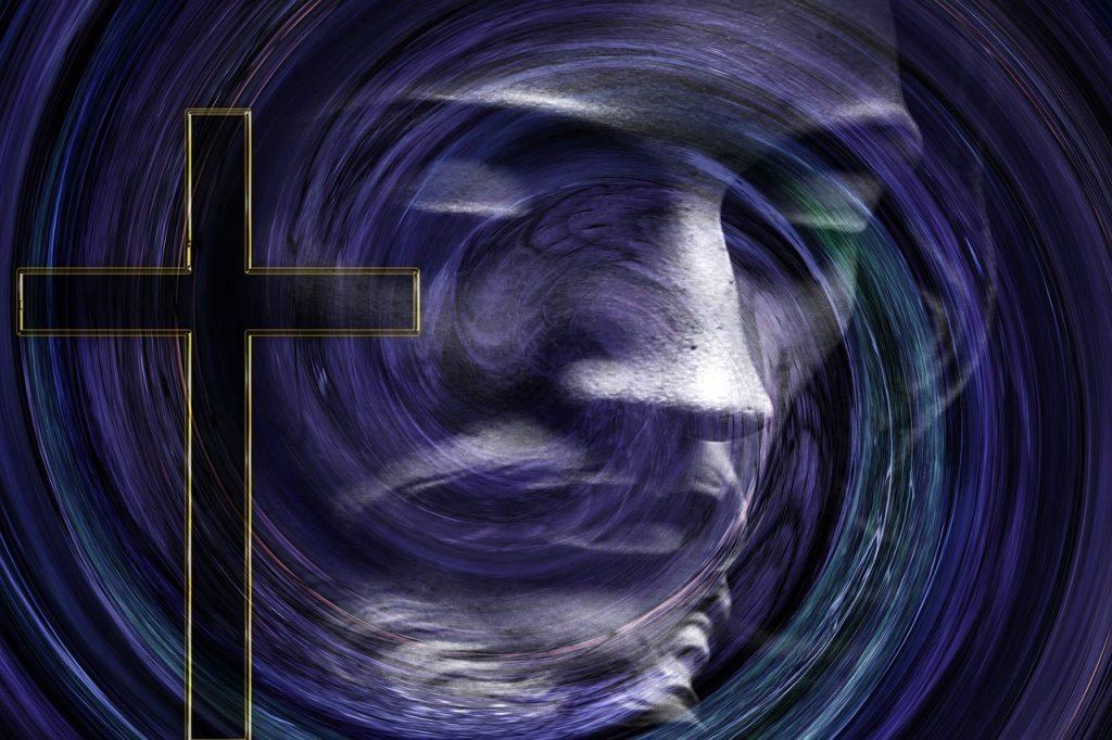 Das Gesicht Jesu Christi, wie in einem Strudel verzerrt, neben einem schlichten schwarzen Kreuz