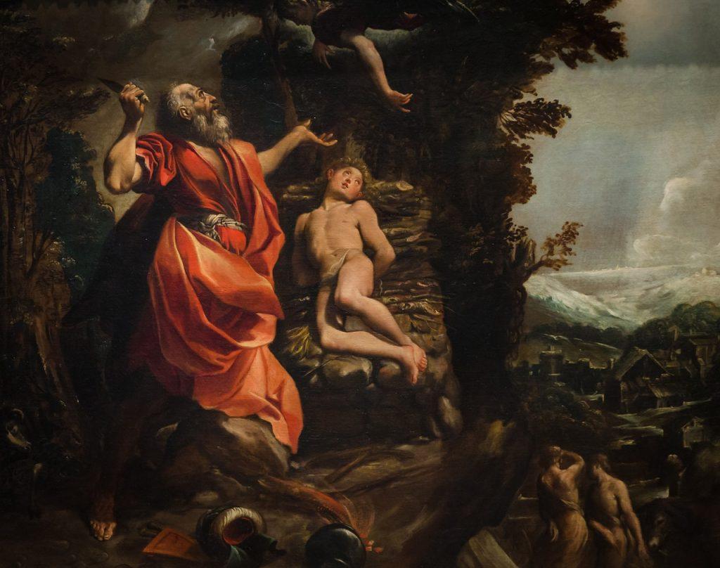 Düsteres Bild von Abraham auf dem Berg Morija; er zückt sein Messer, um den nackt auf dem Altar liegenden Sohn Isaak zu schlachten, während sich ein Engel von oben Einhalt gebietend herabbeugt