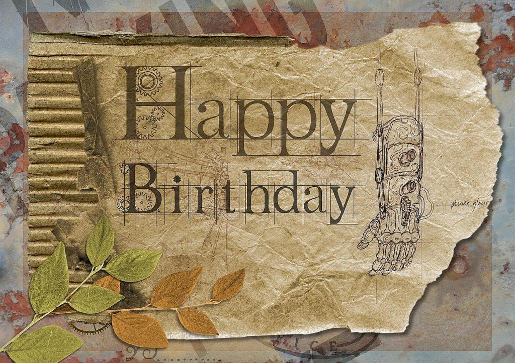 """Eine selbst gestaltete Karte zum Geburtstag mit konstruierter Ersatzhand und Schriftzug """"Happy Birthday"""""""