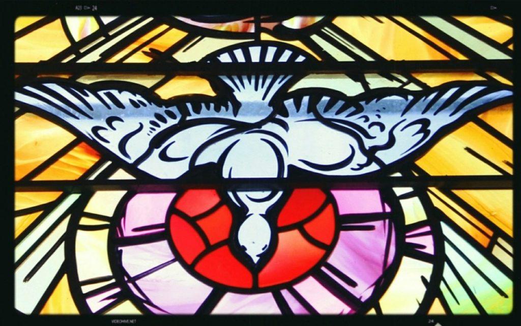 Taube des Heiligen Geistes vor einem roten Kreis dargestellt