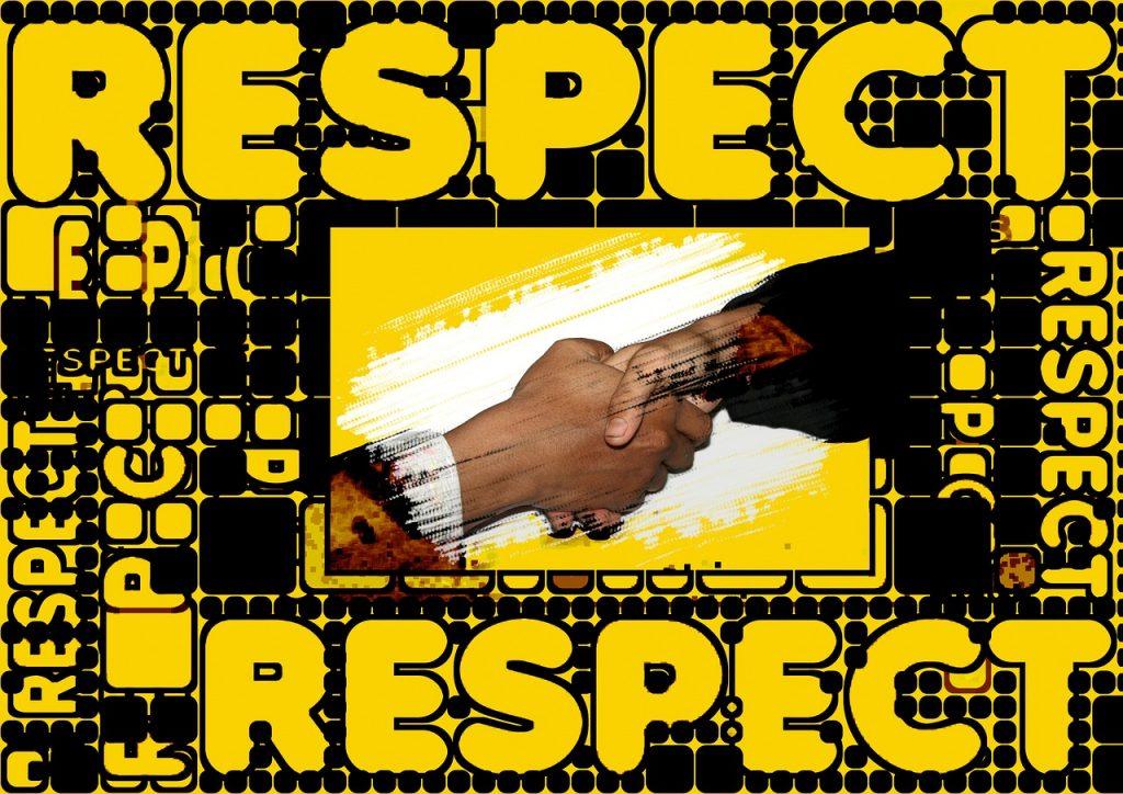 """Händeschütteln, umgeben von Schriftzügen: """"Respect"""""""