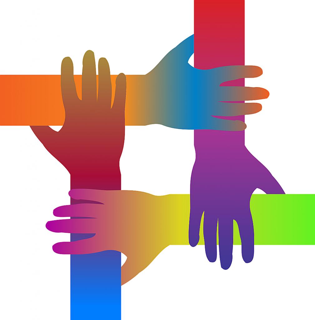"""Vier farbig gestaltete Hände ergreifen sich gegenseitig, so dass ein Symbol für """"einander annehmen"""" entsteht."""