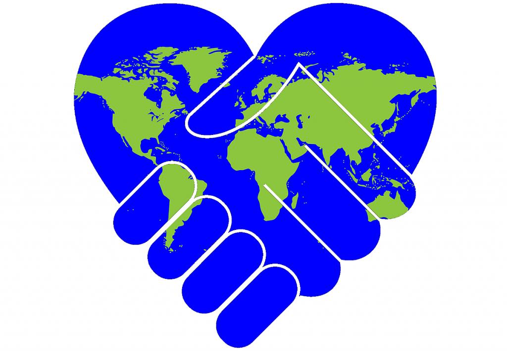 Ein Herz, auf dem die Weltkarte abgebildet ist und das einen Händedruck darstellt
