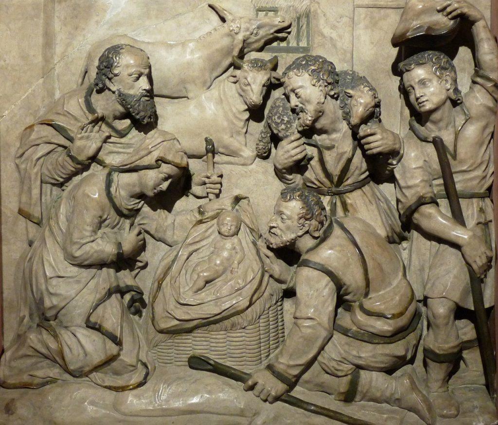 Maria und Josef scharen sich gemeinsam mit drei Hirten um die Krippe mit dem Jesuskind; die Szene ist bräunlich-grau gestaltet, sehr schlicht