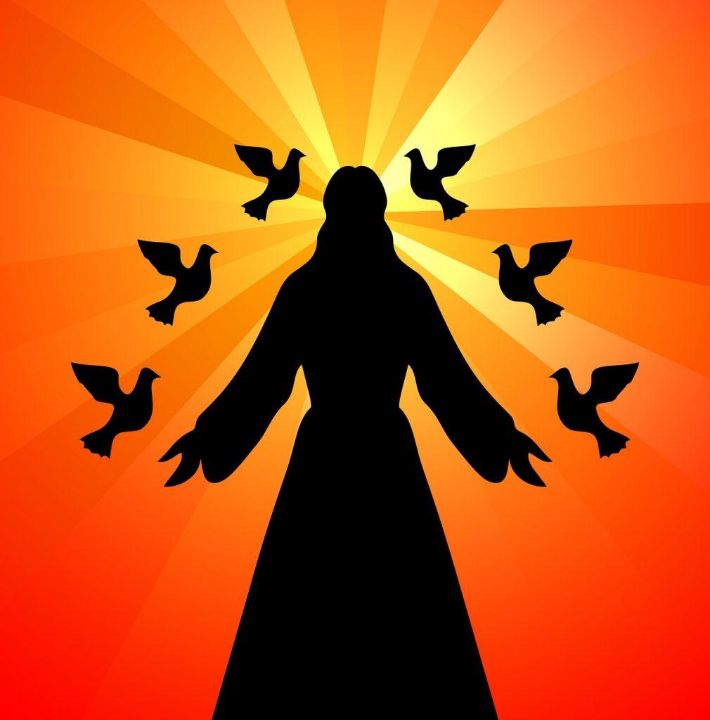 Man sieht die Silhouette von Jesus, von dem rot-gelb-orangene Lichtstrahlen ausgehen und den sechs Taubensilhouetten umgeben