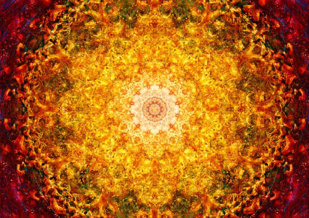 """Ein Mandala """"Blume des Lebens"""" in leuchtend rotgelben Farben"""