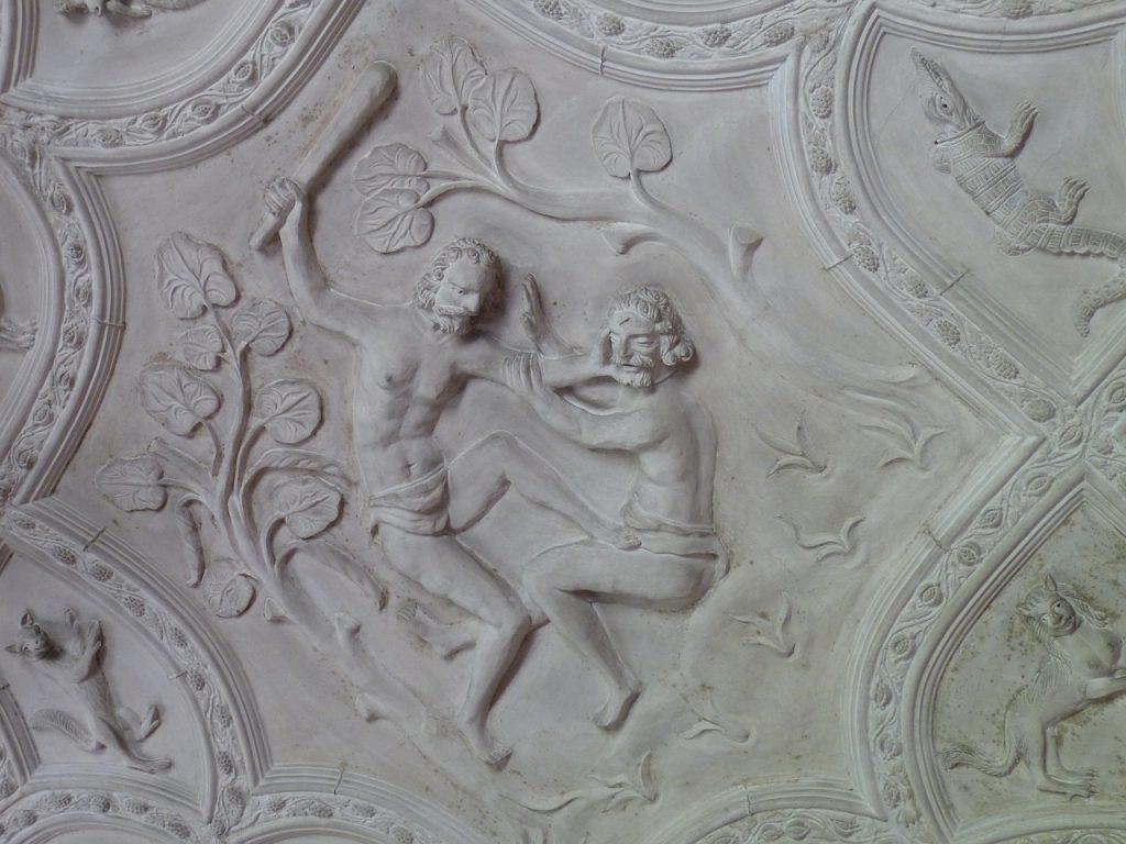 Kain erschlägt Abel mit einer Keule