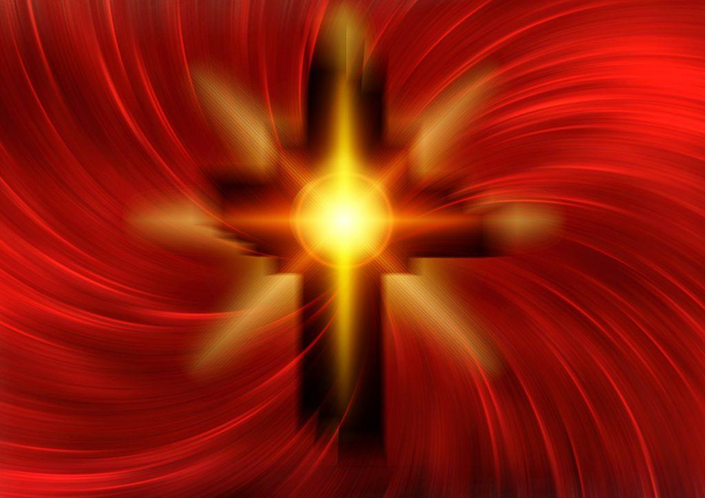 Kreuz mit rotgelben Lichtspiralen