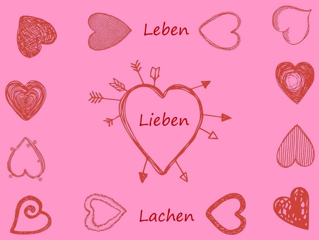 Ein Blatt mit verschiedenen Herzen und den Worten: Leben - Lieben - Lachen