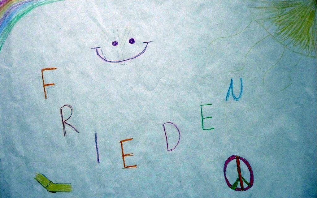 """Ein Friedensbild mit Peace-Rad, Regenbogen, Sonne und den Schriftzug """"Frieden"""""""