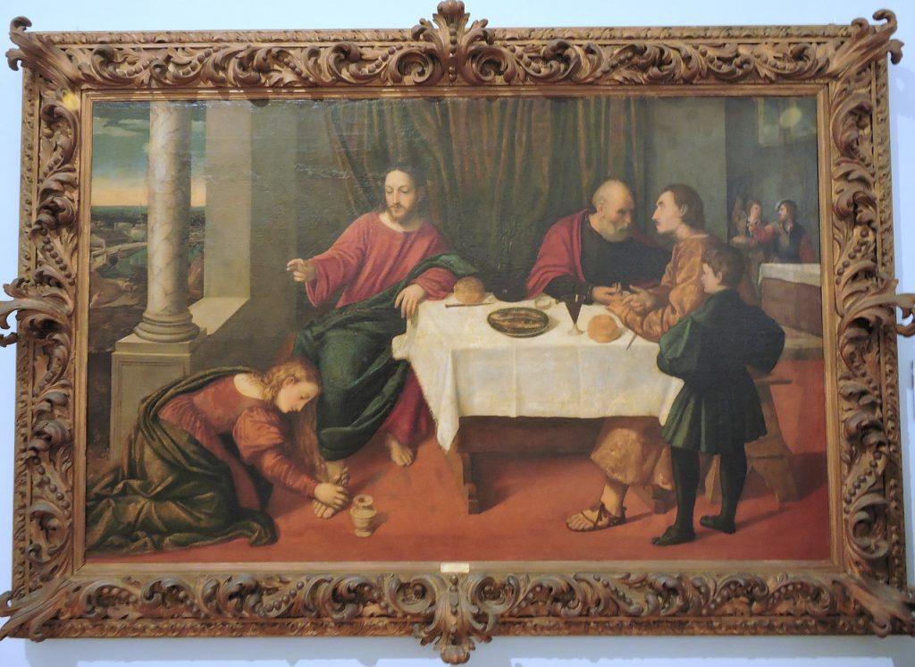 Jesus lässt bei einem Gastmahl eine zärtliche Fußsalbung von einer Frau zu