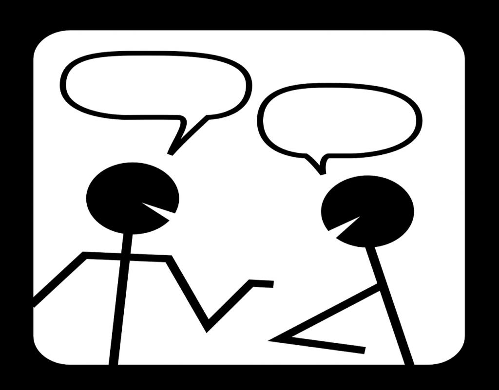 Zwei Strichmännchen mit Sprechblasen im Gespräch