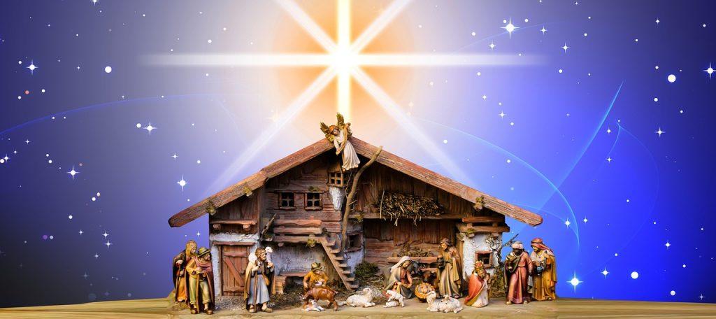 Stall mit Krippe von Bethlehem mit großem leuchtendem Stern darüber