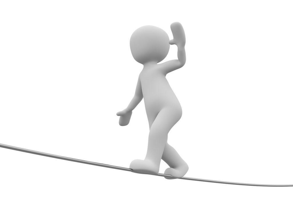 Hochseilartist - stilisiertes Männchen auf einem Seil