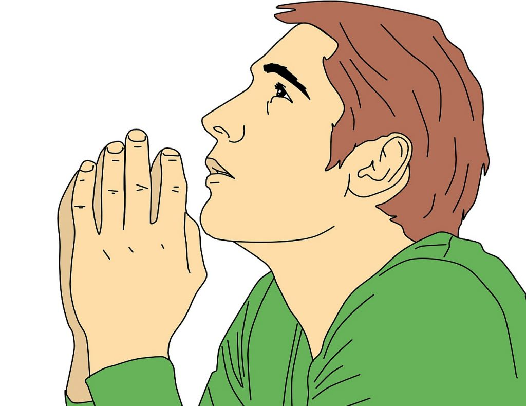 """Ein betender relativ junger Mann - zum Thema """"Gesundbeten"""""""