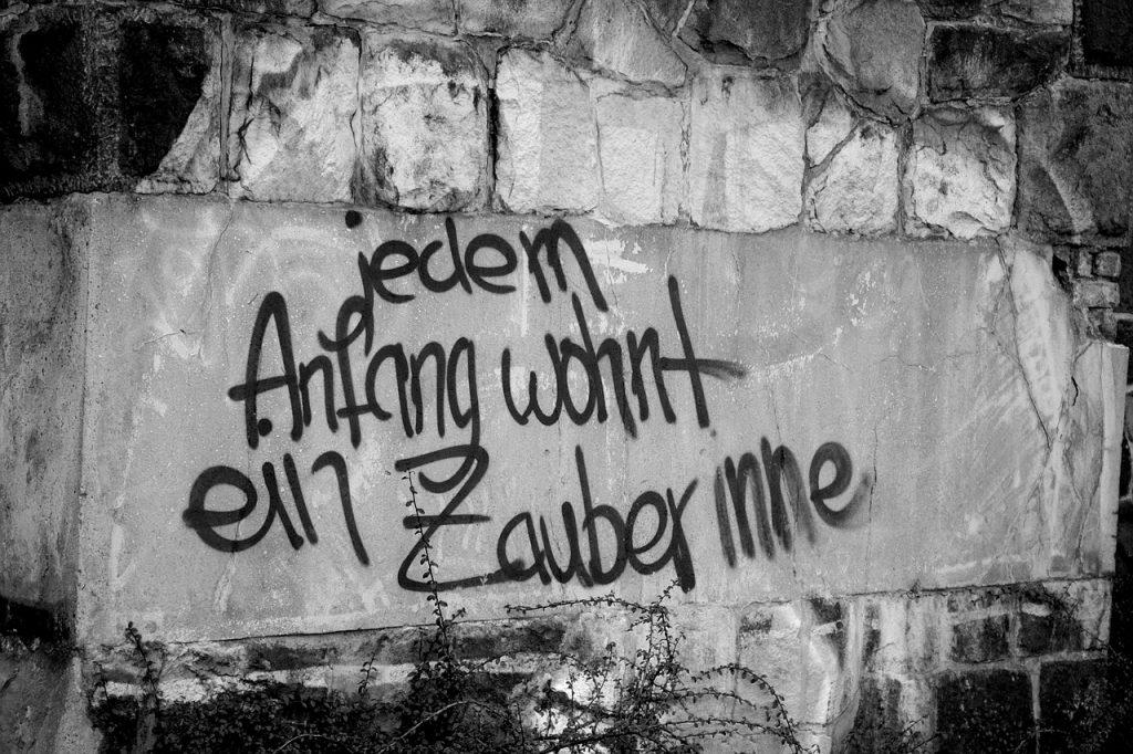 """Graffito: """"Jedem Anfang wohnt ein Zauber inne"""""""