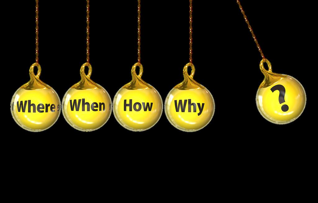 """Vom Warum zum Wozu: Vier an Schnüren nebeneinander hängende Kugeln mit den Fragen """"Wo"""", """"Wann"""", """"Wie"""", """"Warum"""" sollen von einer fünften Kugel mit einem Fragezeichen angestoßen werden."""