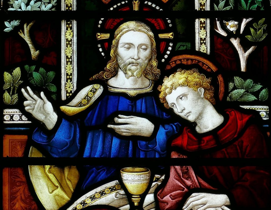 Stained-glass window with Jesus and the Beloved Disciple reclining to his bosom